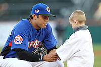 Buffalo Bisons third baseman Matt Tuiasosopo #7 signs an autograph for a young fan during a game against the Gwinnett Braves at Coca-Cola Field on May 17, 2012 in Buffalo, New York.  Buffalo defeated Gwinnett 4-2.  (Mike Janes/Four Seam Images)
