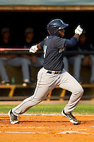 Jabari Henry #47 of the Pulaski Mariners follows through on his swing against the Bluefield Blue Jays at Bowen Field on July 1, 2012 in Bluefield, West Virginia.  The Mariners defeated the Blue Jays 4-3.  (Brian Westerholt/Four Seam Images)