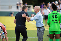 CARY, NC - SEPTEMBER 12: Portland Thorns head coach Mark Parsons and NC Courage head coach Paul Riley shake hands after a game between Portland Thorns FC and North Carolina Courage at WakeMed Soccer Park on September 12, 2021 in Cary, North Carolina.