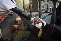 Medics aid and treat injured protesters that fell on the field.  Kiev, Ukraine