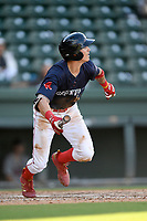 Right fielder Jarren Duran (35) of the Greenville Drive bats runs out a batted ball in Game 1 of a doubleheader against the Rome Braves on Friday, August 3, 2018, at Fluor Field at the West End in Greenville, South Carolina. Rome won, 7-6. (Tom Priddy/Four Seam Images)