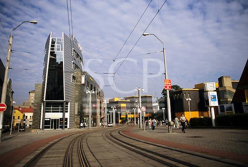 Liberec, Czech Republic. Modern town street with tram lines, McDonald's advertisement, modern building.