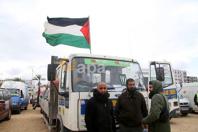 Members of a British aid convoy stand near their car in Gaza City, 10 March 2009. British MP George Galloway arrived in Gaza at the head of an aid convoy to protest what he called Israel's 'genocidal aggression' against the Hamas enclave and support the Palestinian 'resistance'. APAIMAGES PHOTO / Ashraf Amra