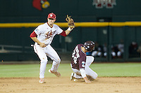 Indiana Hoosiers shortstop Michael Basil (7) tags out Mississippi State Bulldogs baserunner Hunter Renfroe (34) as he attempts to steal second base during Game 6 of the 2013 Men's College World Series on June 17, 2013 at TD Ameritrade Park in Omaha, Nebraska. The Bulldogs defeated Hoosiers 5-4. (Andrew Woolley/Four Seam Images)