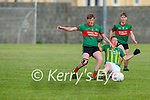 Beale's Diarmuid O'Mahony and Lispole's Matthew Sean Griffin tussle for possession, in the County Senior football league
