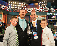 Pitcher Kodi Medeiros (Waiakea  H.S. (HI)) the number 12 overall pick to the Milwaukee Brewers with former Pittsburgh Pirates infielder Jack Wilson and his kids during the MLB Draft on Thursday June 05,2014 at Studio 42 in Secaucus, NJ.   (Tomasso DeRosa/ Four Seam Images)