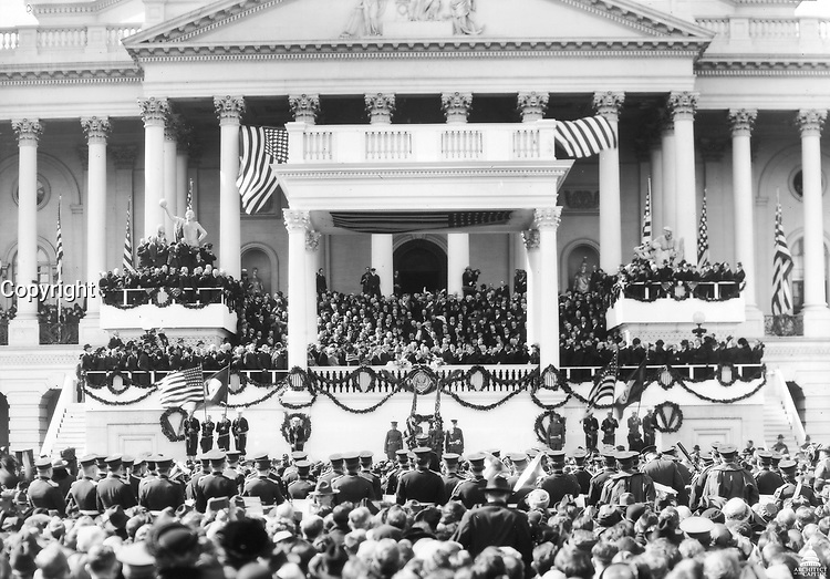 Chief Justice Edward White gives the Oath of Office to Warren Harding on March 4, 1921 on the East Front of the U.S. Capitol Building.<br /> <br /> Photo by Architect of the Capitol photographers.
