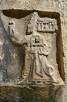 Sculpture of  god Sharruma and King Tudhaliya from the 13th century BC Hittite religious rock carvings of Yazılıkaya Hittite rock sanctuary, chamber B,  Hattusa, Bogazale, Turkey.