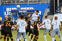KANSAS CITY, UNITED STATES - AUGUST 25: Jaylin Lindsey #26 of Sporting Kansas City heads the ball from a corner kick  a game between Houston Dynamo and Sporting Kansas City at Children's Mercy Park on August 25, 2020 in Kansas City, Kansas.