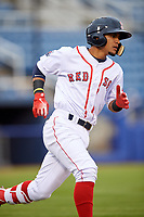 Salem Red Sox shortstop Santiago Espinal (5) runs to first base after hitting a single during the first game of a doubleheader against the Potomac Nationals on June 11, 2018 at Haley Toyota Field in Salem, Virginia.  Potomac defeated Salem 9-4.  (Mike Janes/Four Seam Images)