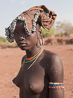 beautiful Mursi young girl with scaring in Omo valley Ethiopia