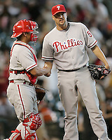 Phillies catcher Carlos Ruiz congratulates pitcher Clay Condrey after beating the Astros on Sunday May 25th at Minute Maid Park in Houston, Texas. Photo by Andrew Woolley / Four Seam Images.