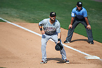 Akron RubberDucks first baseman Jeremy Lucas (12) holds a runner on with umpire Rich Grassa looking on during the second game of a doubleheader against the Bowie Baysox on June 5, 2016 at Prince George's Stadium in Bowie, Maryland.  Bowie defeated Akron 12-7.  (Mike Janes/Four Seam Images)