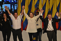 BOGOTÁ -COLOMBIA. 15-06-2014. Juan Manuel Santos (Der)candidato por el partido de La Unidad Nacional su esposa Maria Clemencia (segunda Der-Izq) y su fórmula vicepresidencial Germán Vargas Lleras (segundo Izq-Der) durante su discurso después de ganar las eleccciones presidenciales para el período constitucional 2014-18 en Colombia a Oscar Ivan Zuluaga del partido Centro Democratico. La segunda vuelta de la elección de Presidente y vicepresidente de Colombia se cumplió hoy 15 de junio de 2014 en todo el país./ Juan Manuel Santos (R) candidate by National Unity party his wife Maria Clemencia (second from R) and his runmate German Vargas Lleras (secnd fron L) during his speech after wininning the Presidential elections for the constitutional period 2014-15 in Colombia to Oscar Ivan Zuluaga by Democratic Center party. The second round of the election of President and vice President of Colombia that took place today June 15, 2014 across the country. Photo: VizzorImage/ Gabriel Aponte / Staff