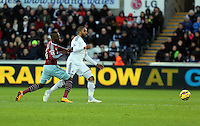 Pictured L-R: Enner Valencia of West Ham and Ashley Williams of Swansea Saturday 10 January 2015<br /> Re: Barclays Premier League, Swansea City FC v West Ham United at the Liberty Stadium, south Wales, UK