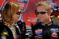 Apr 9, 2006; Las Vegas, NV, USA; NHRA Top Fuel driver Melanie Troxel, driver of the Skull Gear/Torco Race Fuels dragster spends a moment with her husband, Tommy Johnson Jr. driver of the Skoal Funny Car prior to the start of final eliminations at the SummitRacing.com Nationals at Las Vegas Motor Speedway in Las Vegas, NV. Mandatory Credit: Mark J. Rebilas