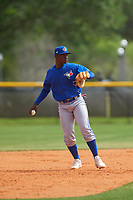 Toronto Blue Jays Peniel Brito (60) throws to first base during an exhibition game against the Canada Junior National Team on March 8, 2020 at Baseball City in St. Petersburg, Florida.  (Mike Janes/Four Seam Images)