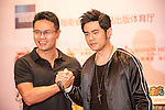 Mission Hills Chairman and CEO Ken Chu (left) shakes hands with Singer Jay Chou during a press conference on the sidelines of World Celebrity Pro-Am 2016 Mission Hills China Golf Tournament on 20 October 2016, in Haikou, China. Photo by Weixiang Lim / Power Sport Images