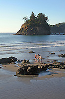 Teens walking along the rocky beach, Trinidad, California