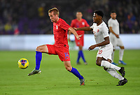 ORLANDO, FL - NOVEMBER 15: Jackson Yueill #14 of the United States moves with the ball past Jonathan David #20 of Canada during a game between Canada and USMNT at Exploria Stadium on November 15, 2019 in Orlando, Florida.