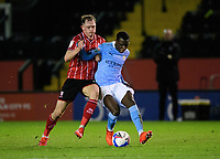 Lincoln City's Theo Archibald vies for possession with Manchester City U21's Claudio Gomes<br /> <br /> Photographer Chris Vaughan/CameraSport<br /> <br /> EFL Papa John's Trophy - Northern Section - Group E - Lincoln City v Manchester City U21 - Tuesday 17th November 2020 - LNER Stadium - Lincoln<br />  <br /> World Copyright © 2020 CameraSport. All rights reserved. 43 Linden Ave. Countesthorpe. Leicester. England. LE8 5PG - Tel: +44 (0) 116 277 4147 - admin@camerasport.com - www.camerasport.com