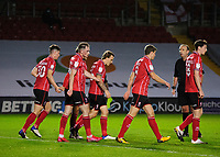 Lincoln City's Harry Anderson, centre, celebrates scoring the opening goal with team-mates<br /> <br /> Photographer Andrew Vaughan/CameraSport<br /> <br /> EFL Papa John's Trophy - Northern Section - Group E - Lincoln City v Manchester City U21 - Tuesday 17th November 2020 - LNER Stadium - Lincoln<br />  <br /> World Copyright © 2020 CameraSport. All rights reserved. 43 Linden Ave. Countesthorpe. Leicester. England. LE8 5PG - Tel: +44 (0) 116 277 4147 - admin@camerasport.com - www.camerasport.com