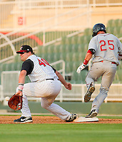 First baseman Dan Black #40 of the Kannapolis Intimidators tries to back-hand a low throw as Bryce Brentz #25 of the Greenville Drive crosses the bag at Fieldcrest Cannon Stadium on May 8, 2011 in Kannapolis, North Carolina.   Photo by Brian Westerholt / Four Seam Images