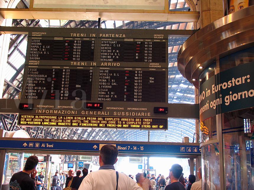 Train arrival departure board Centrale F. S. train station, Milan, Ital