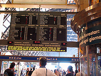 Train arrival departure board Centrale F. S. train station, Milan, Ital