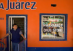 ALGODONES, MEXICO-MARCH 22 : A tout looks for customers to enter his pharmacy March 22, 2005 in Algodones. Unlike in the U.S., prescriptions are not required to purchase medications in Mexico. Many Americans travel to Mexico to take advantage of lower drug prices outside the country. ©Radhika Chalasani
