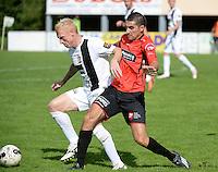 Winkel Sport - SK Deinze  : Roel Van Hemert (links) aan de bal voor Rachid Elbarkaoui (r) <br /> foto VDB / BART VANDENBROUCKE
