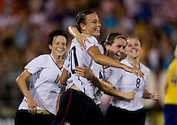 Abby Wambach (20) of the USWNT celebrates her goal with teammate Heather O'Reilly (9) at Rentschler Field in East Hartford, Connecticut.  The USWNT defeated Sweden, 3-0.