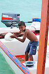 Young boy helping out on a boat