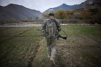 A soldier from 3rd Platoon, Charlie Company, 1-26 Infantry returns to base following a meeting with village elders.