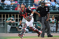 Great Lakes Loons catcher Jose Capellan (6) looks for a pop up foul ball in front of umpire Malachi Moore during a game against the Fort Wayne TinCaps on August 19, 2013 at Dow Diamond in Midland, Michigan.  Great Lakes defeated Fort Wayne 12-5.  (Mike Janes/Four Seam Images)