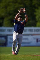 State College Spikes third baseman Ronnierd Garcia (40) catches a popup during a game against the Batavia Muckdogs August 23, 2015 at Dwyer Stadium in Batavia, New York.  State College defeated Batavia 8-2.  (Mike Janes/Four Seam Images)