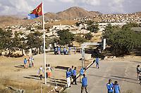 Eritrea. Anseba province. Keren. Keren secondary school. Students, wearing blue uniforms, walk under the eritrean flag.   © 2006 Didier Ruef