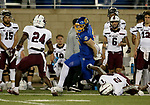 BROOKINGS, SD - MAY 2: Tucker Kraft #85 of the South Dakota State Jackrabbits slips the grasp of D'Ante' Cox #2 as teammate Qua Brown #24 of the Southern Illinois Salukis closes in at Dana J Dykhouse Stadium on May 2, 2021 in Brookings, South Dakota. (Photo by Dave Eggen/Inertia)