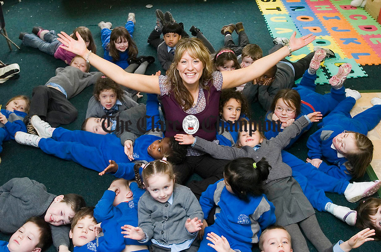 Sarah Burke, a teacher at St. Tola's, Shannon, who has been awarded a Frostburg Fellowship to study for a Masters degree in Education, pictured with some of her pupils Photograph by John Kelly