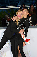 Director Andrea Arnold (L) celebrates with Sasha Lane after being awarded the Jury Prize for the film 'American Honey' during the Palme D'Or Winner Photocall during the 69th annual Cannes Film Festival at the Palais des Festivals on May 22, 2016 in Cannes, France.