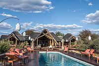 Africa, Botswana, Khwai, The Lodge, Feline Fields, edge of the Kalahari desert. Pool area.