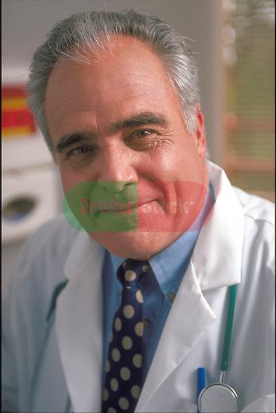 portrait of smiling elder doctor in lab coat