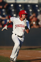 J.C. Cardenas (18) of the Vancouver Canadians runs to first base during a game against the Tri-City Dust Devils at Nat Bailey Stadium on July 23, 2015 in Vancouver, British Columbia. Tri-City defeated Vancouver, 6-4. (Larry Goren/Four Seam Images)