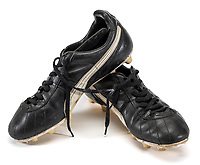 BNPS.co.uk (01202) 558833. <br /> Pic: GrahamBuddAuctions/BNPS<br /> <br /> A pair of Diego Maradona's football boots have emerged for sale for £30,000.<br /> <br /> The pint-sized Argentinian phenomenon owned them in 1986, the year he broke English hearts with his 'hand of God' goal as he captained his nation to World Cup glory in Mexico.<br /> <br /> The match-worn Puma size eight black leather boots have a white side strip and the brand name in silver letters.