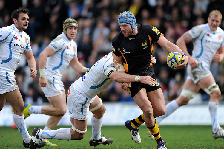 James Haskell of London Wasps offloads in the tackle during the Aviva Premiership match between London Wasps and Exeter Chiefs at Adams Park on Sunday 21st April 2013 (Photo by Rob Munro)