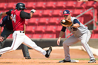 Carolina's Edgar Gonzalez (24) lunges back to first base as Tennessee's Jesus Cota awaits a pick-off attempt at Five County Stadium in Zebulon, NC, Sunday, July 2, 2006.  The Mudcats defeated the Smokies 4-0.