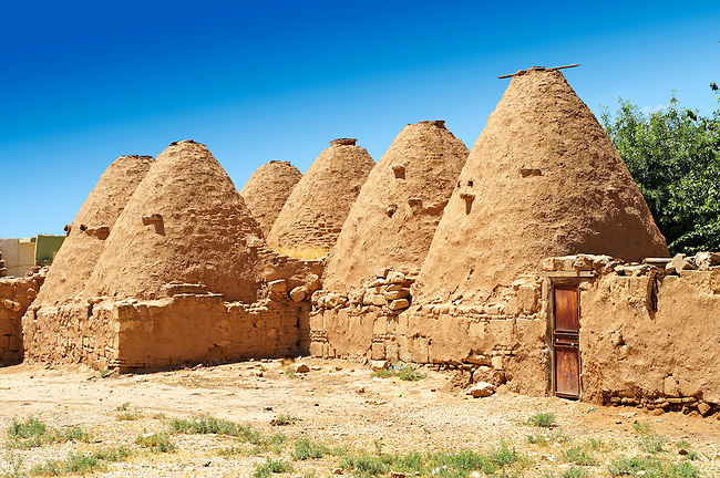 """Pictures of the beehive adobe buildings of Harran, south west Anatolia, Turkey.  Harran was a major ancient city in Upper Mesopotamia whose site is near the modern village of Altınbaşak, Turkey, 24 miles (44 kilometers) southeast of Şanlıurfa. The location is in a district of Şanlıurfa Province that is also named """"Harran"""". Harran is famous for its traditional 'beehive' adobe houses, constructed entirely without wood. The design of these makes them cool inside. 44"""