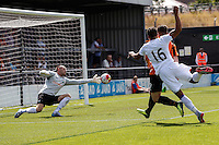 Graham Stack of Barnet saves a shot from Dwight Gayle of Crystal Palace (16) during the Friendly match between Barnet and Crystal Palace at The Hive, London, England on 11 July 2015. Photo by David Horn.