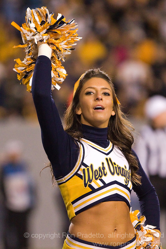WVU cheerleader. The WVU Mountaineers beat the Pitt Panthers 21-20 at Mountaineer Field in Morgantown, West Virginia on November 25, 2011.