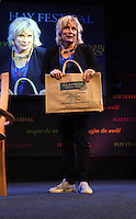 Saturday 24 May 2014, Hay on Wye UK<br /> Pictured: Jennifer Saunders holding a Claridge Nursing Home bag on stage.<br /> Re: The Telegraph Hay Festival, Hay on Wye, Powys, Wales UK.